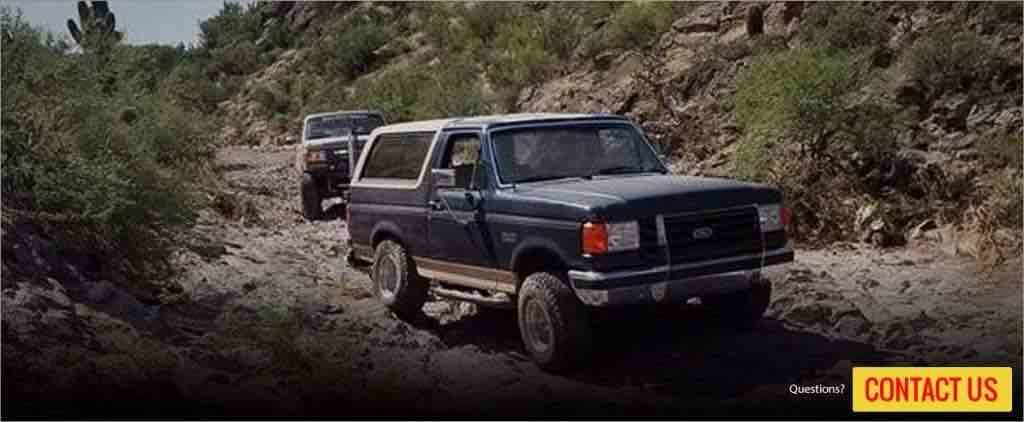 2 Ford Bronco's driving off road in Arizona.